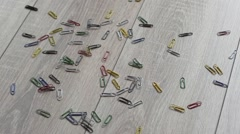 Paperclip spilled on a beautiful wooden floor. Stock Footage