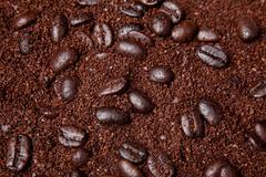 Coffee grounds and whole beans background Stock Photos