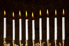 Burning hanukkah candles in a menorah Stock Photos