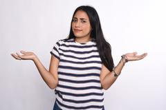 Indecisive young woman - stock photo