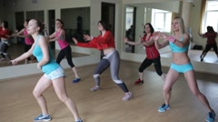 Group of women dancing and doing aerobic exercises - stock footage