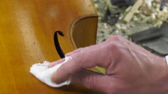 A luthier the polished surface of a baroque instrument Stock Footage