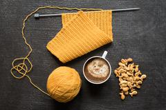 Knitting, cup of coffee and fish crackers - stock photo