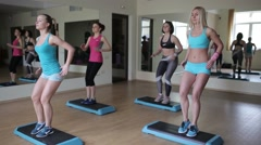 Female group doing aerobics in gym - stock footage