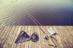 Vintage toned fishing equipment. - stock photo