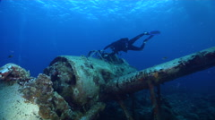 Male model scuba diver taking images in lagoon in Palau (Micronesia), HD, Stock Footage