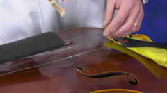 Luthier sets up and adjusts the easel Stock Footage