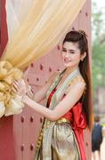 Thai woman dressing traditional. - stock photo