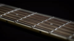 Guitar neck with strings closeup Stock Footage