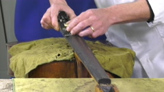 A luthier replaces the touch of a cello Stock Footage