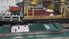 Grab loading cargo onto ship, Port of Rio Grande, Brazil Stock Footage