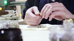 Female Hands Creating A Mixture of Aroma Therapy Mix. Crushing Dry Herbs. Stock Footage