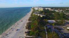 Overhead view of beautiful tropical beach with people on the seaside Stock Footage
