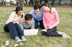Friends studying together on the park - stock photo