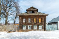 Old village house in countryside in Russia Stock Photos