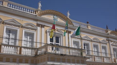 Flags fly from Municipal building, Rio Grande, Brazil Stock Footage