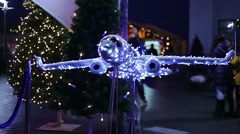 Decorative airplane made of sparkling twinkle lights at airport, Christmas tours Stock Footage