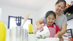 4K : Happy Asian mother baking cookie with little daughter in kitchen Stock Footage