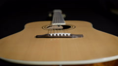 Light yellow acoustic guitar close-up. Modern design Stock Footage
