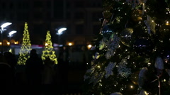 Festive night on central square of big city decorated with nice New Year trees Stock Footage