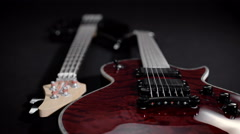 Red electric guitar and black bass, lie side by side Stock Footage