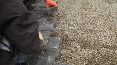 Worker puts sidewalk tile Stock Footage