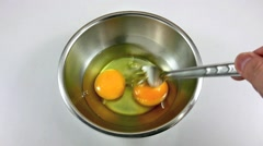 Beat eggs in stainless steel bowl Stock Footage