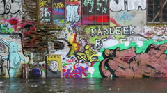 River Flows Past Graffiti Painted Building in Oslo Norway Stock Footage