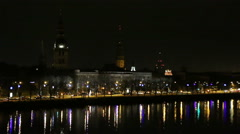 Riga Old Town panorama at dusk over Daugava river Stock Footage