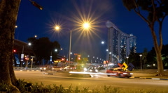 Singapore Timelapse Raffles Ave at Night Traffic Cars Stock Footage