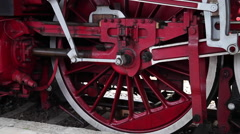 Close up of an old steam engine locomotive with big wheels at trains exhibition Stock Footage