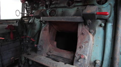 Interior of an old train steam engine locomotive with rusty furnace - stock footage