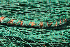 Green fishing net pattern background Stock Photos