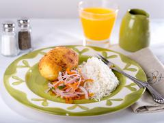 Papa Rellena, a fried potato with meat filling, a typical Peruvian dish Stock Photos