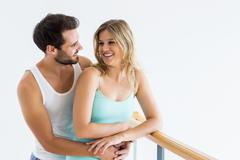 Young couple standing near the railing - stock photo