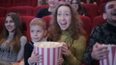 people watching movie in cinema and laughing - stock footage