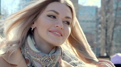 Beautiful young woman smiling. Walking in the city Stock Footage