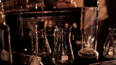 Mad scientist lab test tubes skull table Stock Footage