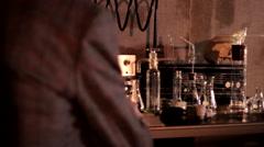 Stock Video Footage of mad scientist lab test tubes skull table