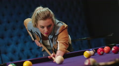 CU beautiful blonde girl playing pool in slow motion 4K - stock footage