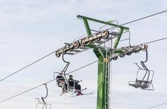 Cableway or ski lift chairs in Czech mountains - stock photo
