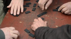 Man Mixing Dominoes On The Rough Table Top Stock Footage