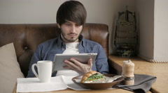 Handsome Young Man Freelancer with Modern Laptop in Cafe taking Cup of Coffee Stock Footage