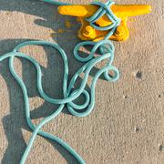 Mooring bollard with rope on pier by the sea Stock Photos