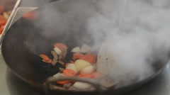 Close Up On Vegetables And Slices Of Ham Frying In Wok Pan Stock Footage