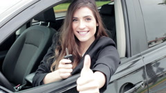 Beautiful woman showing key of new car smiling happy thumb up Stock Footage