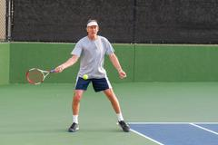 Tennis player hitting open stance forehand. Stock Photos