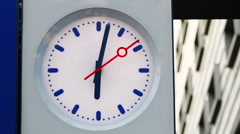 clock with red arrow on the scoreboard - stock footage