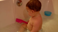 Portrait Baby is play in a bath  Stock Footage