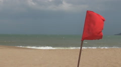 Empty red flag fluttering in the wind. sea strong waves. Tropics. Asia. Stock Footage